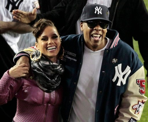 "In this Oct. 29, 2009 file photo, singers Alicia Keys, left, and Shawn ""JAY-Z"" Carter leave the field at Yankee Stadium after performing before Game 2 of the Major League Baseball World Series in New York. (AP Photo/Eric Gay, file)"