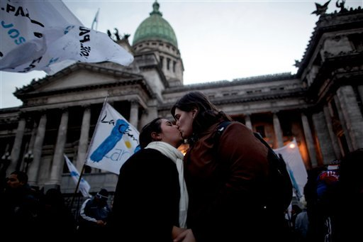 A gay couple kisses outside Argentina's congress during a rally to support a proposal to legalize same-sex marriage in Buenos Aires, Wednesday, July 14, 2010. (AP Photo/ Natacha Pisarenko)