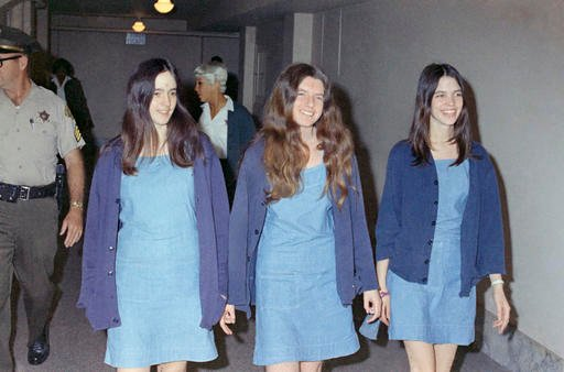 In this Aug. 20, 1970 file photo, Charles Manson followers, from left: Susan Atkins, Patricia Krenwinkel and Leslie Van Houten, walk to court to appear for their roles in the 1969 cult killings of seven people, including pregnant actress Sharon Tate.