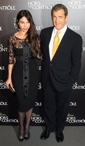 """In this Feb. 4, 2010 file photo, Mel Gibson and Oksana Grigorieva arrive at the """"Edge Of Darkness"""" Premiere in Paris. (AP Photo/Jacques Brinon, file)"""