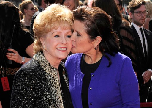 In this Sept. 10, 2011, file photo, Debbie Reynolds, left, and Carrie Fisher arrive at the Primetime Creative Arts Emmy Awards in Los Angeles.