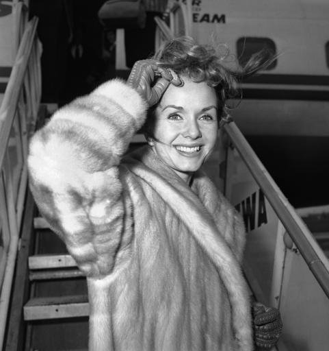 In this March 6, 1959, file photo actress Debbie Reynolds boards an airliner in New York en route to Spain where she will film a new picture.