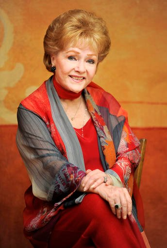 In this May 21, 2013 file photo, actress Debbie Reynolds poses for a portrait in Beverly Hills, Calif.