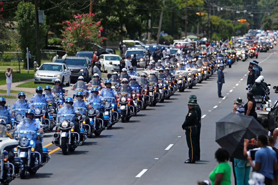 The funeral procession for slain Baton Rouge police corporal Montrell Jackson leaves the Living Faith Christian Center in Baton Rouge, La., Monday, July 25, 2016.