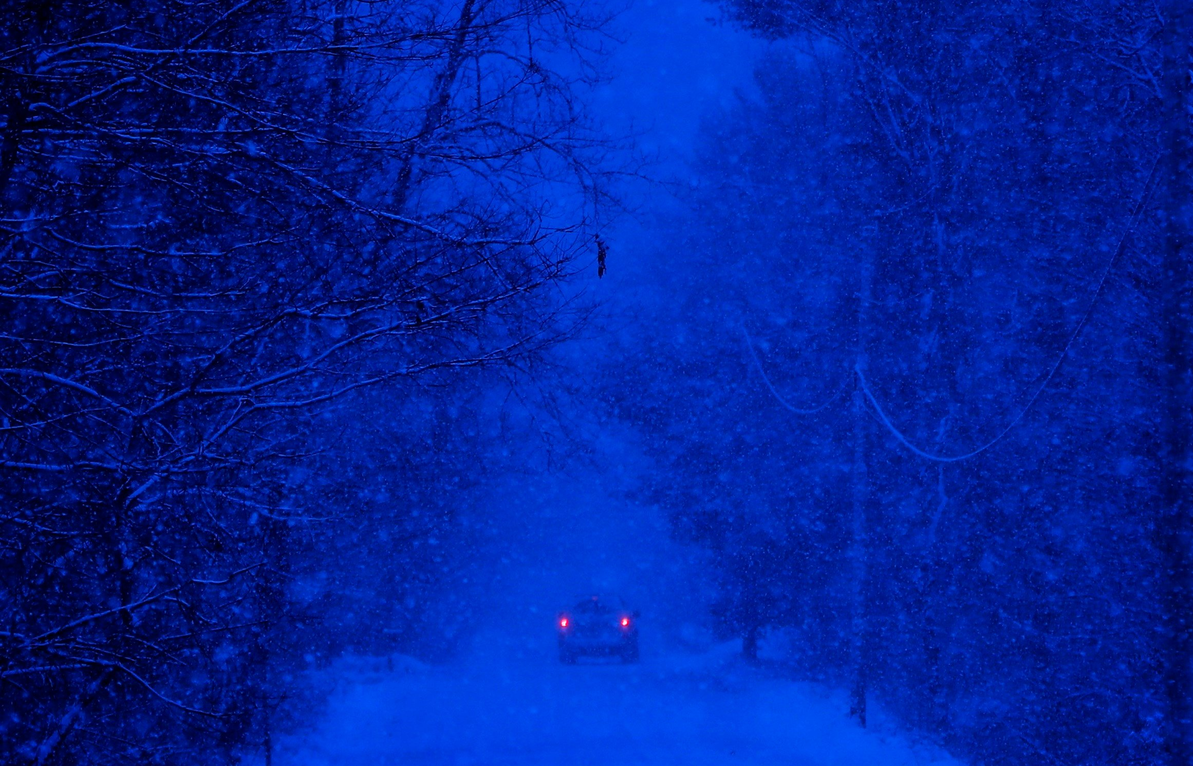 A motorist drives through a snow storm in Durham, Maine, Thursday, Dec. 29, 2016. (AP Photo/Robert F. Bukaty)