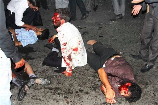 This picture released by Iran's official IRNA news agency shows the victims of a bomb blast in the city of Zahedan, 940 miles (1570 kilometers) southeast of the capital Tehran, Iran, Thursday, July 15, 2010. (AP Photo/Islamic Republic News Agency, IRNA)