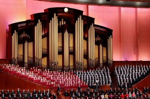 In this Oct. 1, 2016, file photo, the Mormon Tabernacle Choir of The Church of Jesus Christ of Latter-day Saints, sings in the Conference Center at the morning session of the two-day Mormon church conference.