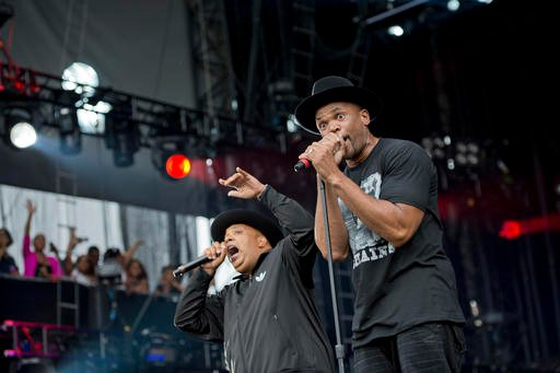 "In this Sept. 2, 2012 file photo, Joseph ""Run"" Simmons, left, and Darryl ""DMC"" McDaniels of Run-DMC perform at the ""Made In America"" music festival in Philadelphia."
