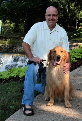 In this July 14, 2010 photo, Roger Woodward, who survived going over Niagara Falls 50 years ago, when he was 7, poses with his dog River at a nature park in Huntsville, Ala. (AP)