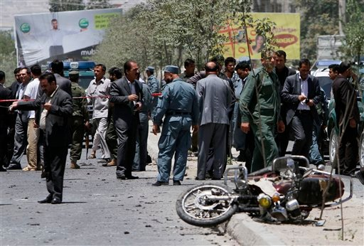 Afghan police and officials are at the scene of a suicide bombing in Kabul, Afghanistan, Sunday, July 18, 2010.