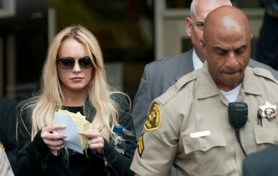Lindsay Lohan, left, exits Beverly Hills Municipal Court on Tuesday, July 6, 2010, in Beverly Hills, Calif. (AP Photo/Adam Lau)