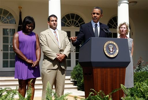 President Barack Obama stands with, from left to right: Denise Gibson from Brooklyn, N.Y., Jim Chukalas from Fredon Township, N.J., and Leslie Macko from Charlottesville, Va., all unemployed. (AP Photo/Charles Dharapak)