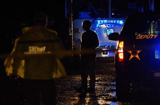 Emergency crews gather at the scene after a storm ripped through a mobile home killing several people in Rehobeth, Ala. (Jay Hare/Dothan Eagle via AP)