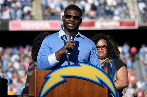 Former San Diego Chargers running back LaDainian Tomlinson gestures during a halftime ceremony in an NFL football game between the Chargers and the Kansas City Chiefs Sunday, Nov. 22, 2015, in San Diego.