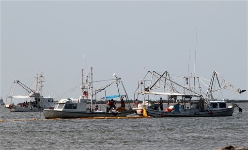 Vessels of opportunity skim oil from the waters around Grand Isle, La., Monday, July 19, 2010. Oil from the Deepwater Horizon incident continues to wash ashore on Grand Isle. (AP Photo/Dave Martin)
