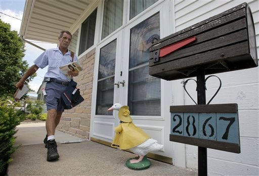 Ohio letter carrier Keith McVey walks his route delivering mail in Akron, Ohio on Friday, July 16, 2010. The veteran mailman has gained a reputation for three-times delivering people from life-threatening situations while on the job delivering mail.