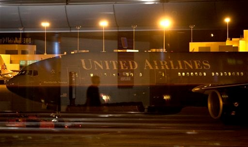 """United Flight Flight 967 is pulled away from the B Concourse at Denver International Airport where it had been diverted after experiencing """"significant turbulence,"""" July 20, 2010."""