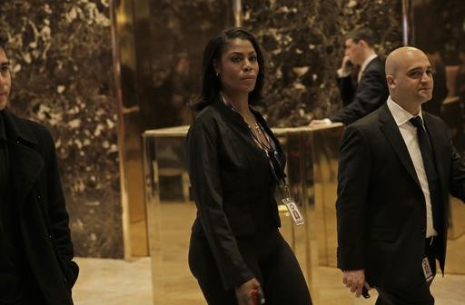Trump advisor Omarosa Manigault, center, walks through the lobby of Trump Tower.