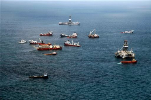 Vessels gather at the Deepwater Horizon oil spill site over the Gulf of Mexico, off the Louisiana coast, Tuesday, July 20, 2010. (AP Photo/Gerald Herbert)