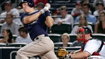 San Diego Padres' Nick Hundley, left, hits the go-ahead two-run double against the Atlanta Braves during the 12th inning of a baseball game in Atlanta, Wednesday July 21, 2010. San Diego won 6-4. (AP Photo/John Amis)
