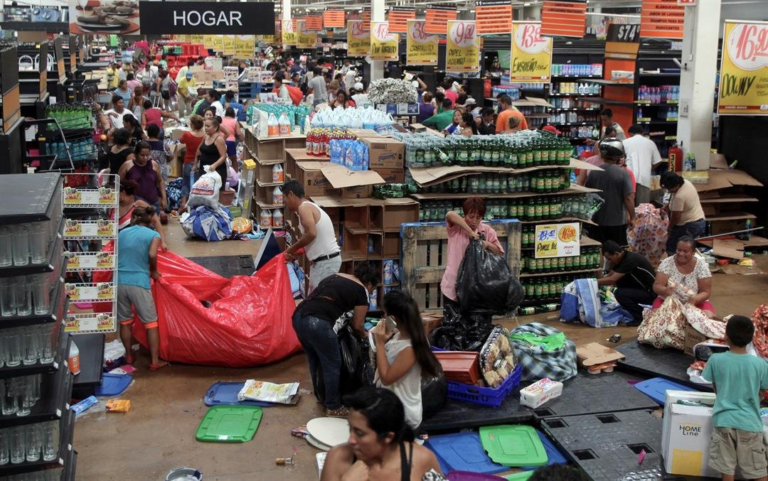 Officials say the unrest has resulted in the death of a policeman, the ransacking of hundreds of stores and arrests of hundreds of people. (AP Photo/Felix Marquez)