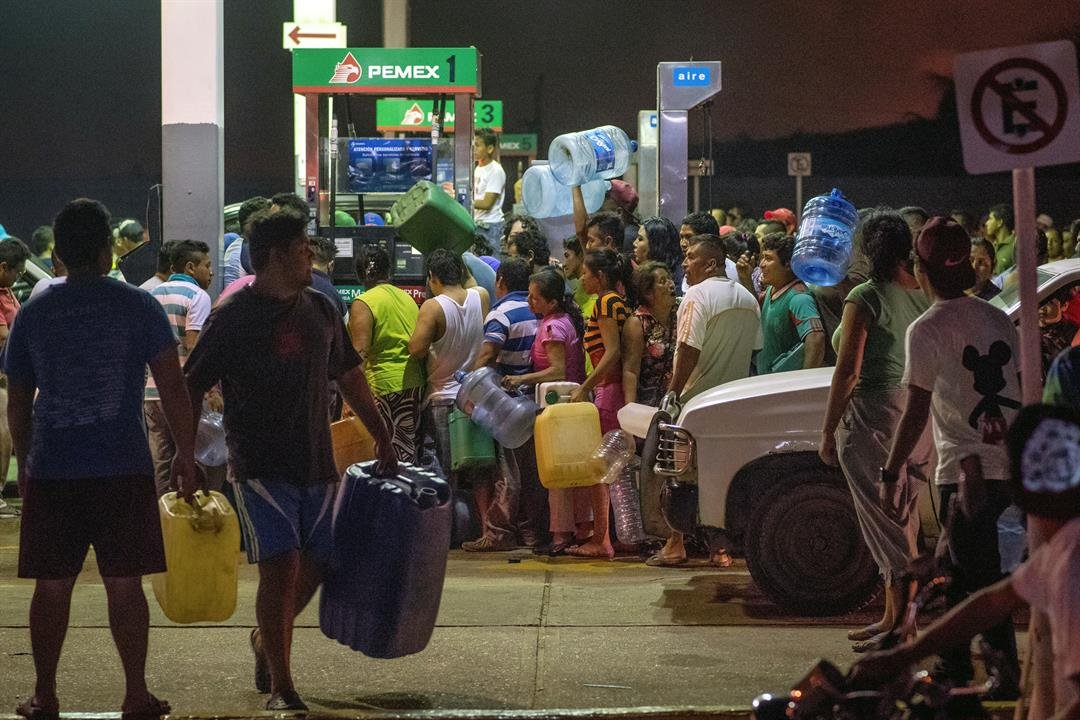 Residents steal gasoline and diesel from a gas station following protests against an increase in fuel prices in Allende, southern Veracuz State, Mexico, late Tuesday Jan. 3, 2017. AP