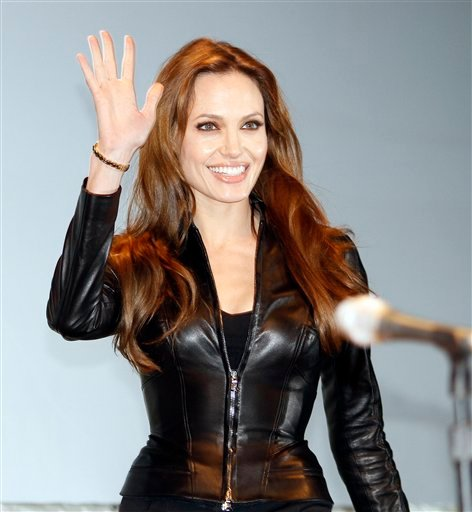 "Actress Angelina Jolie arrives at panel for the movie ""Salt"" at Comic-Con International Thursday, July 22, 2010 in San Diego. (AP Photo/Denis Poroy)"