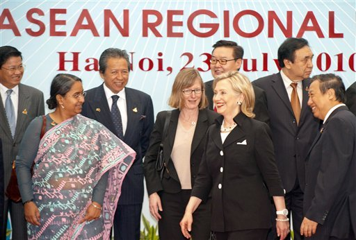 U.S. Secretary of State Hillary Rodham Clinton, center front, walks to her next meeting after participating in a group photo during the 17th ASEAN Regional forum in Hanoi, Vietnam Friday, July 23, 2010. (AP Photo/Paul J. Richards, Pool)