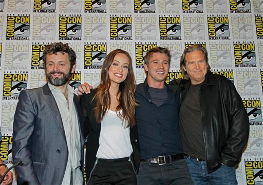 """Cast members of the movie """"Tron"""" from left, Michael Sheen, Olivia Wilde, Garrett Hedlund and Jeff Bridges pose for a photo during Comic-Con International Thursday, July 22, 2010 in San Diego. (AP Photo/Denis Poroy)"""