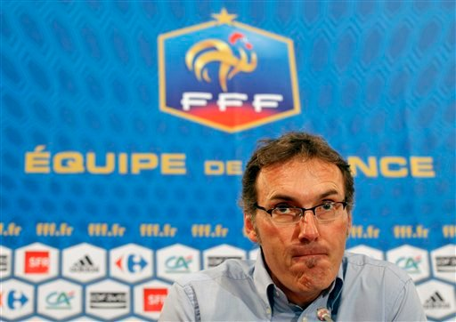 In this July 6, 2010, file photo, new France soccer coach Laurent Blanc reacts during a news conference in Paris.