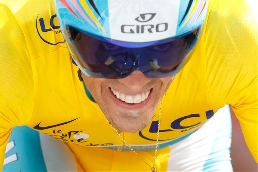 Alberto Contador of Spain, wearing the overall leader's yellow jersey, strains during the 19th stage of the Tour de France cycling race, an individual time trial over 52 kilometers (32.3 miles) Saturday, July 24, 2010. (AP Photo/Laurent Rebours)
