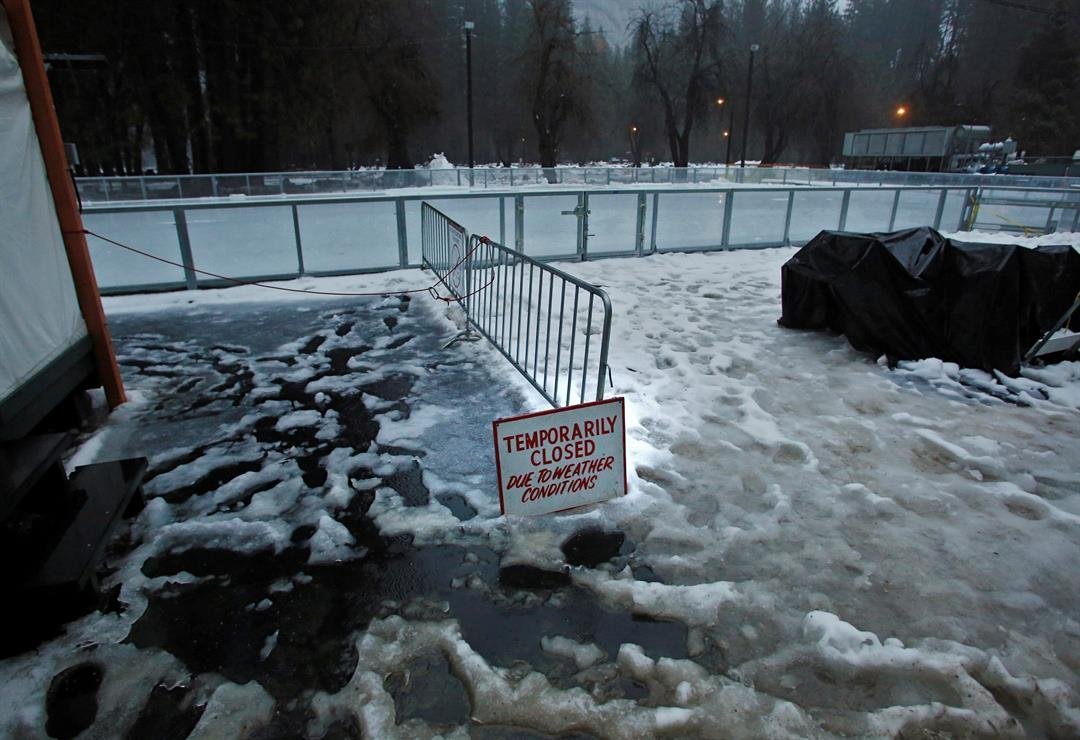 """A """"closed"""" sign stands at the entrance of an ice rink at the Half Dome Village of Yosemite National Park, CA, on Saturday, Jan 7, 2017. (AP Photo/Gary Kazanjian)"""