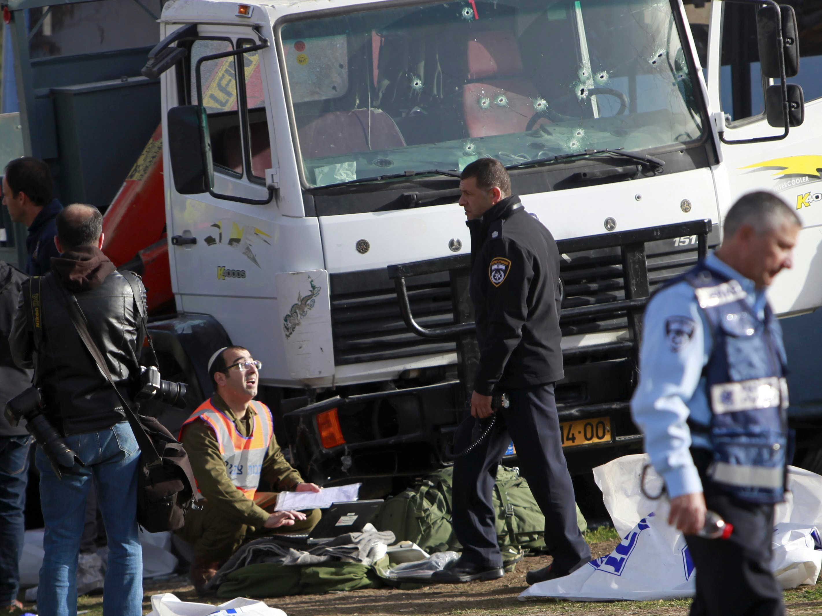 Israeli police investigates the scene of an attack in Jerusalem Sunday, Jan. 8, 2017. (AP Photo/Mahmoud Illean)
