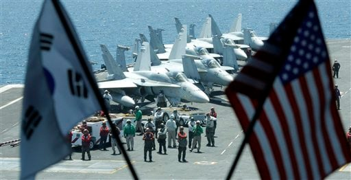 Deck crew members stand on the flight deck of the Nimitz-class USS George Washington during joint military exercises between the U.S. and South Korea in South Korea's East Sea on Monday, July 26, 2010.