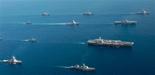 In this photo released by the South Korean Navy, the U.S. nuclear-powered aircraft carrier the USS George Washington, largest, leads a group of South Korean and U.S. warships in formation during joint military drills in South Korea's East Sea.