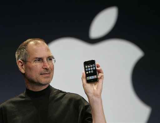 Apple CEO Steve Jobs holds up the new iPhone during his keynote address at MacWorld Conference & Expo in San Francisco, Tuesday, Jan. 9, 2007.