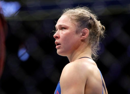 In this Dec. 30, 2016, file photo, Ronda Rousey stands in the cage after Amanda Nunes forced a stoppage in the first round of their women's bantamweight championship mixed martial arts bout at UFC 207 in Las Vegas.