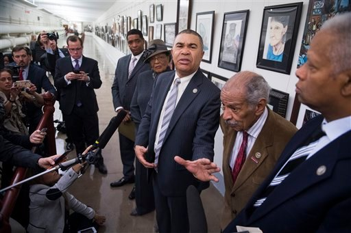 From left, Reps. Cedric Richmond, D-La., Alma Adams, D-N.C., William Lacy Clay, D-Mo., John Conyers, D-Mich., and Hank Johnson, D-Ga., speak in front of the painting by Missouri high school student David Pulphus after it was rehung.