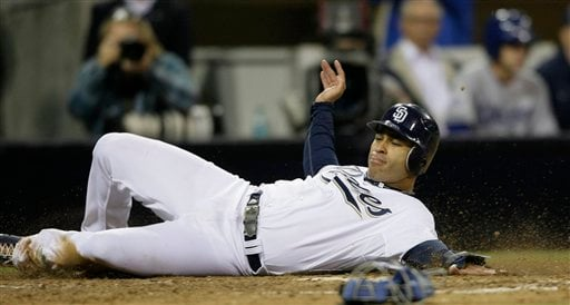 San Diego Padres Jerry Hairston slides in safely to home while scoring off a hit by Chris Denorfia in the seventh inning against the Los Angeles Dodgers during their baseball game Wednesday, July 28, 2010 in San Diego. (AP Photo/Gregory Bull)