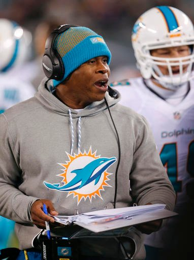 Miami Dolphins defensive coordinator Vance Joseph talks to players during a timeout during the second quarter of an NFL football game against the New York Jets, Saturday, Dec. 17, 2016, in East Rutherford, N.J.