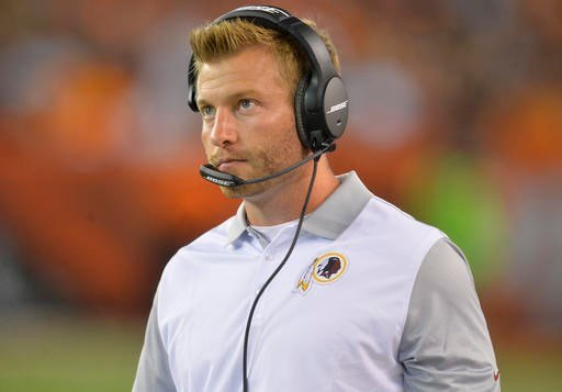 In this Thursday, Aug. 13, 2015 file photo, Washington Redskins offensive coordinator Sean McVay stands on the sideline during an NFL preseason football game against the Cleveland Browns in Cleveland.