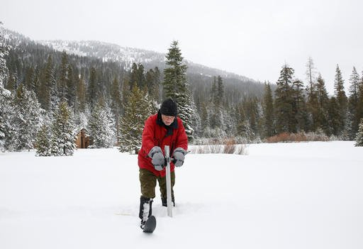 In this Jan. 3, 2017, file photo, Frank Gehrke, chief of the California Cooperative Snow Surveys Program for the Department of Water Resources, plunges the survey tube into the snowpack.