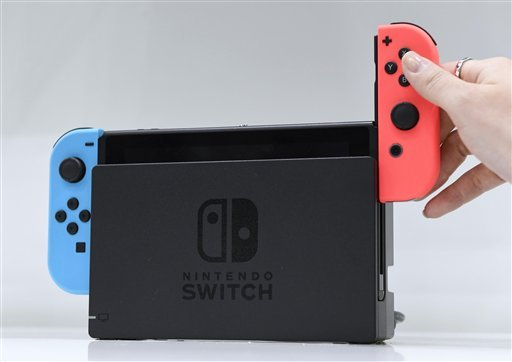 Nintendo Co. unveils its new Switch game console at Tokyo Big Sight on Jan. 13, 2017.