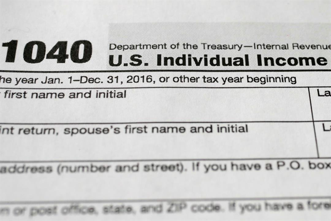 The Internal Revenue Service says to expect a few changes when the nation's individual income tax filing season opens on Jan. 23. (AP Photo/Mark Lennihan)