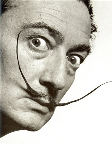 This photo provided by the Philippe Halsman Archive, via the High Museum of Art shows artist Salvador Dali in a 1953 portrait by photographer Philippe Halsman.