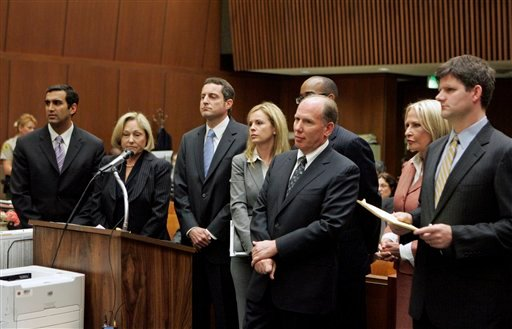 FILE - In this May 13, 2010 photo, defendant Howard K. Stern, third from left, the former manager of Anna Nicole Smith, stands in the courtroom during his arraignment with co-defendants Dr. Sandeep Kapoor, left, and Dr Khristine Eroshevich.