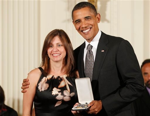 President Barack Obama presents the 2010 Citizens Medal to Susan Retik Ger from Needham, Mass.