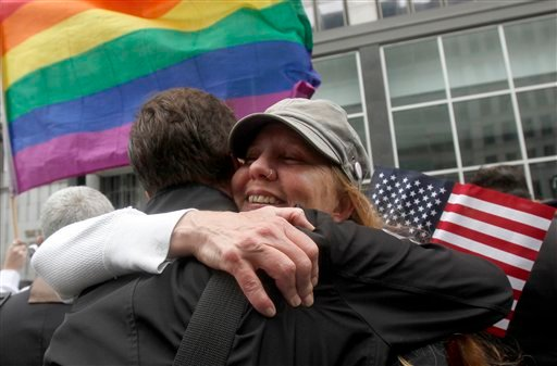 Sheree Red Bornand, right, hugs Aidan Dunn after hearing the decision in the United States District Court proceedings challenging Proposition 8 outside of the Phillip Burton Federal Building in San Francisco Aug. 4, 2010. (AP Photo/Jeff Chiu)