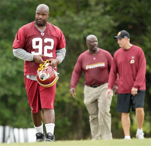 Washington Redskins' Albert Haynesworth, left, walks from the field after training with defensive line coach Jacob Burney, center, and defensive coordinator Jim Haslett at the NFL football team's training camp at Redskins Park, Thursday, Aug. 5, 2010