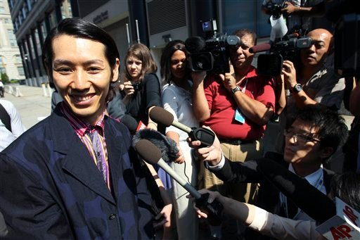 Japanese eating champion Takeru Kobayashi smiles as he speaks to the media after leaving court in New York, Thursday, Aug. 5, 2010.